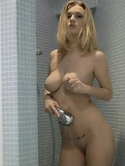 Big breasted blonde Natalia Star gets naughty in the shower aiming the spray at her craving pussy for maximum pleasure